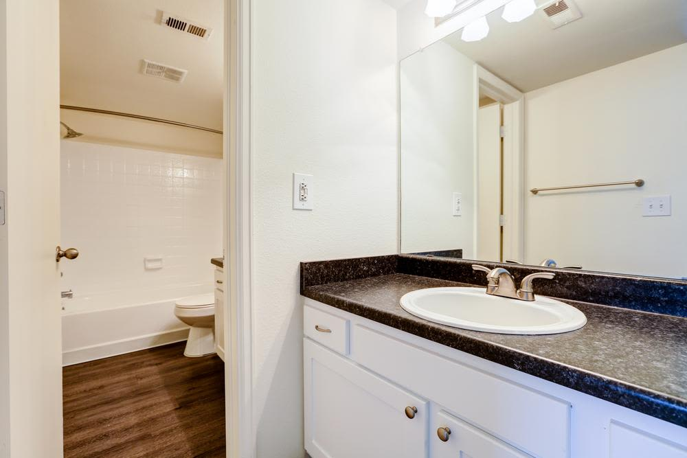 Bright bathroom at Deerfield Apartments in Denver, CO