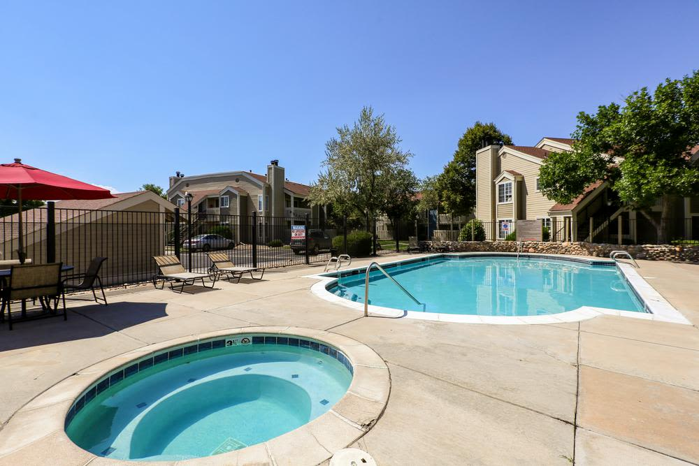 View of the pool from the swim deck at Deerfield Apartments in Denver