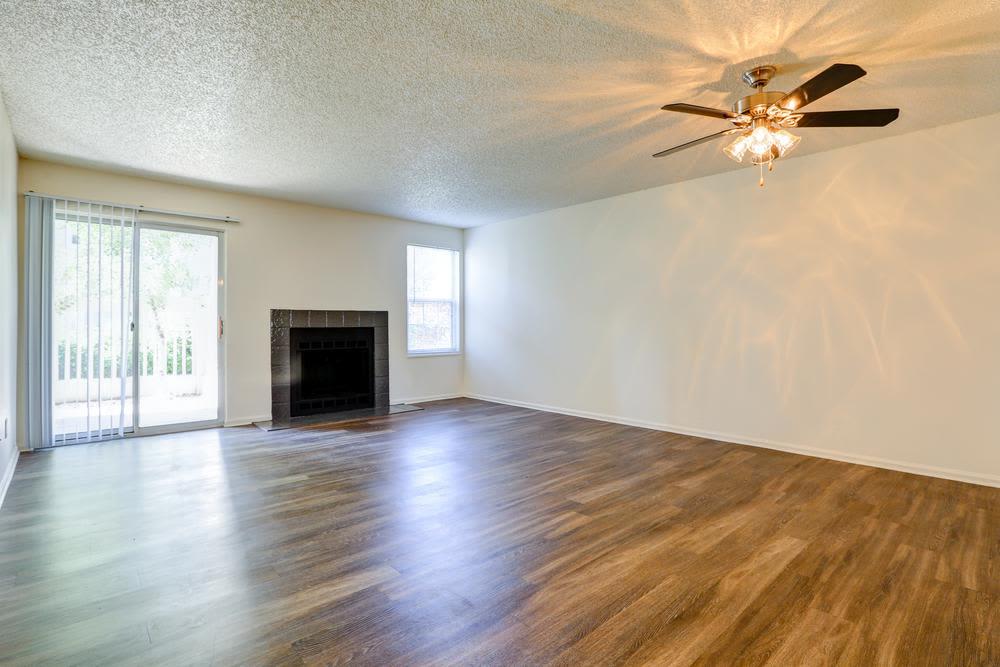 Spacious living room at Deerfield Apartments in Denver, CO
