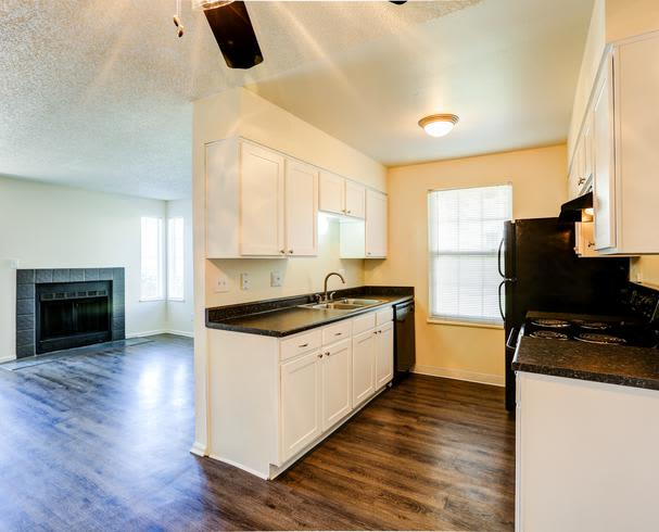 kitchen living room combo at Deerfield Apartments in Denver, CO