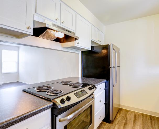 fully equipped kitchen at Deerfield Apartments in Denver, CO