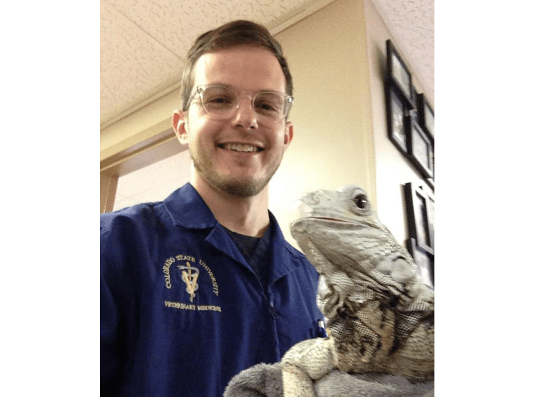 Dr. Dicken with a lizard at Lee's Summit Animal Hospital