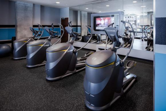 Modern and well-equipped fitness center in Catalyst model home