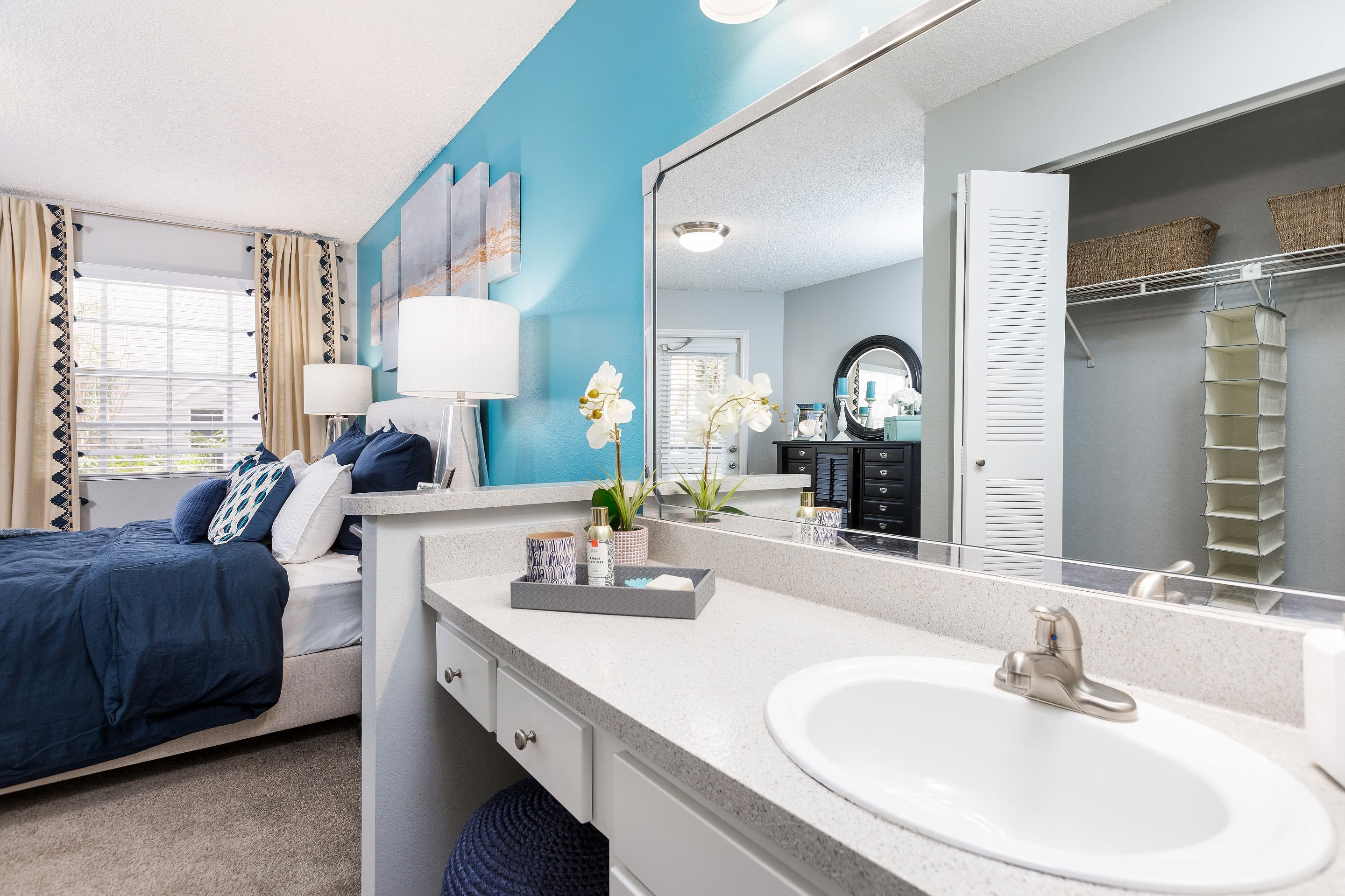 Model bedroom with attached bathroom at Reserve at Lake Irene in Casselberry, Florida