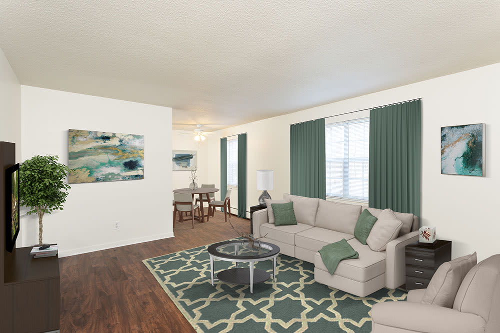Modern living room at Penfield Village Apartments in Penfield, New York