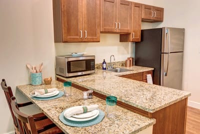 kitchen with dining area at Symphony at Stuart in Stuart, Florida.