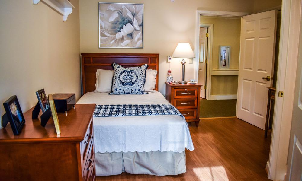 Well-equipped bedroom in Artis Senior Living of Elmhurst model home
