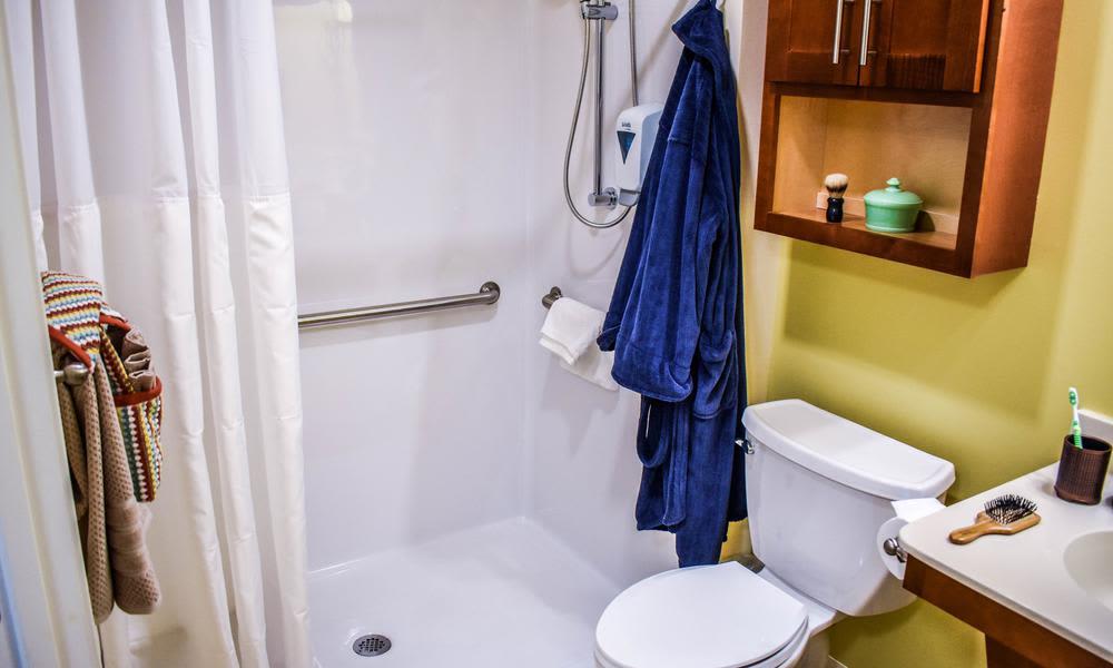 Modern and well-equipped bsthroom in Artis Senior Living of Elmhurst model home