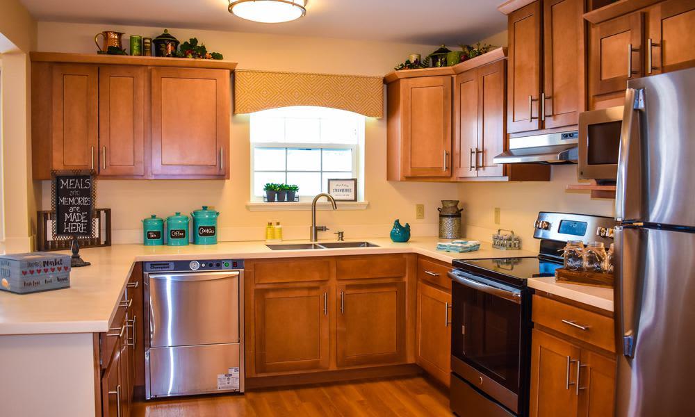 Modern and well-equipped kitchen in Artis Senior Living of Elmhurst model home