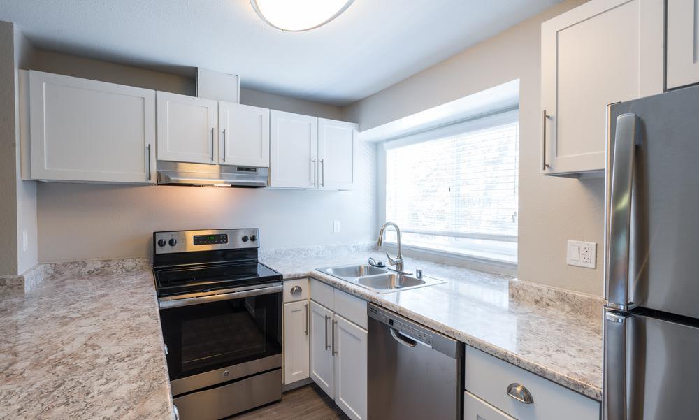 Modern kitchen in model home at Village at Seeley Lake in Lakewood, WA