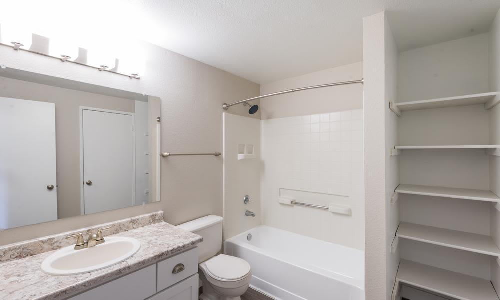 Bathroom with vanity at Village at Seeley Lake in Lakewood, Washington