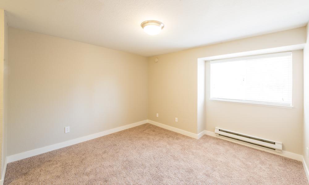 Interior of bedroom at Village at Seeley Lake in Lakewood, WA