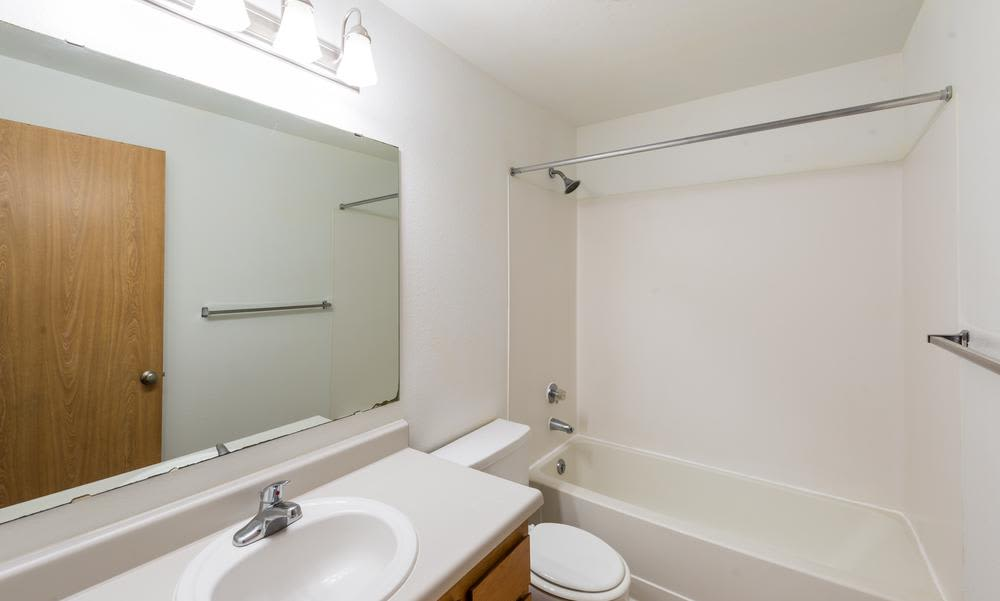 Bathroom with white sink at Village at Seeley Lake in Lakewood, Washington
