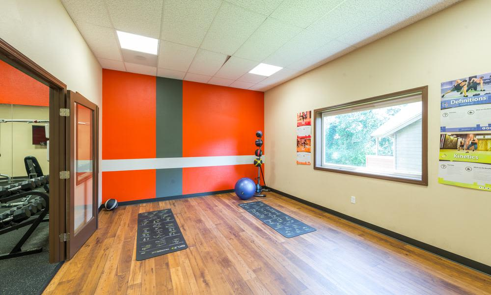 Fitness room at Village at Seeley Lake in Lakewood, Washington