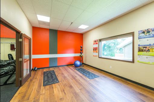 Fitness center featuring exercise ball at Village at Seeley Lake in Lakewood, Washington