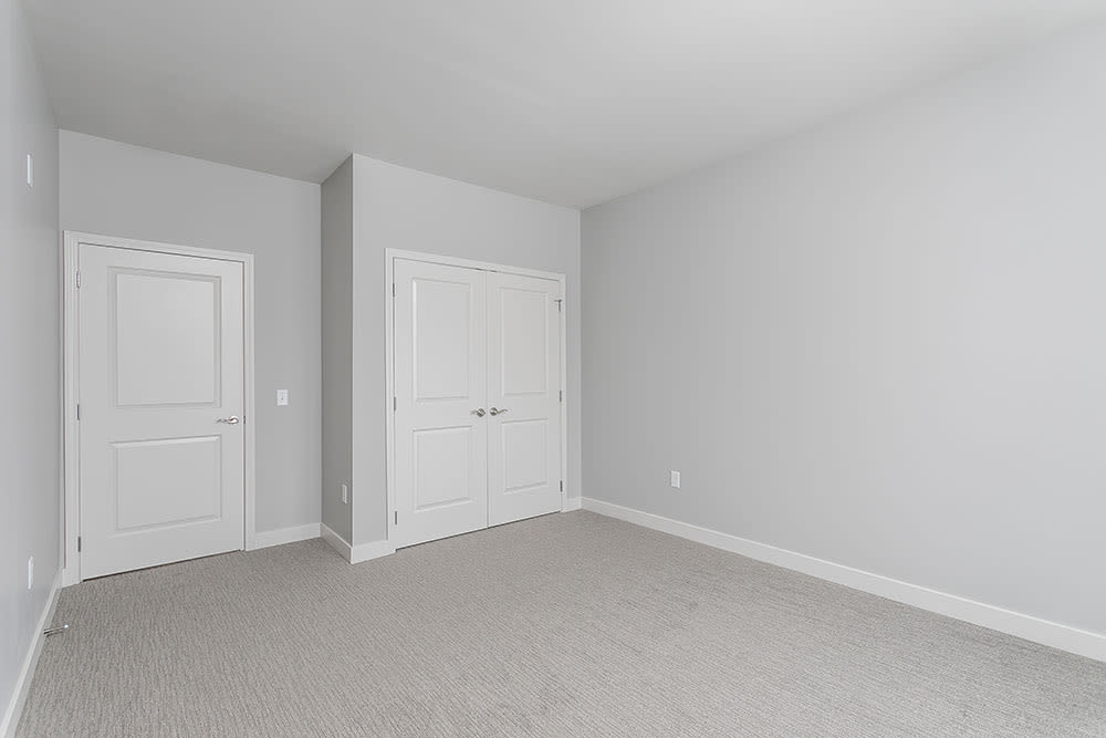 Bedroom at Ellison Heights Apartments in Rochester, New York