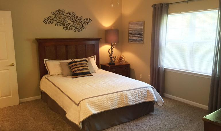 Beautiful bedroom at Mill Pond Village Apartments in Salisbury.