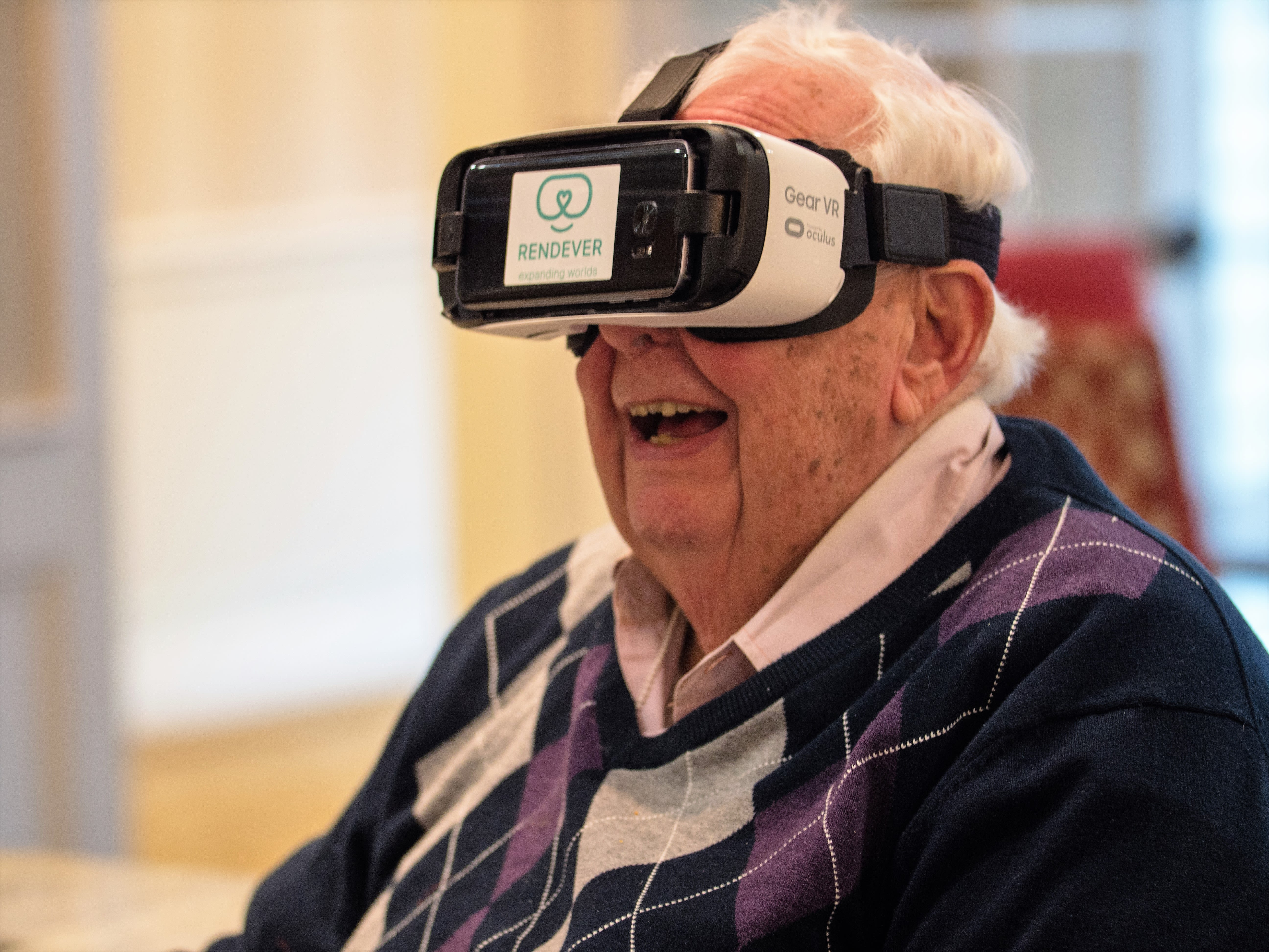 Senior using a VR headset at Maplewood at Southport in Southport, Connecticut