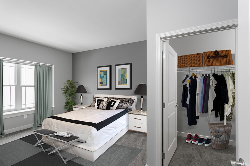 Cozy bedroom at Ellison Heights Apartments in Penfield