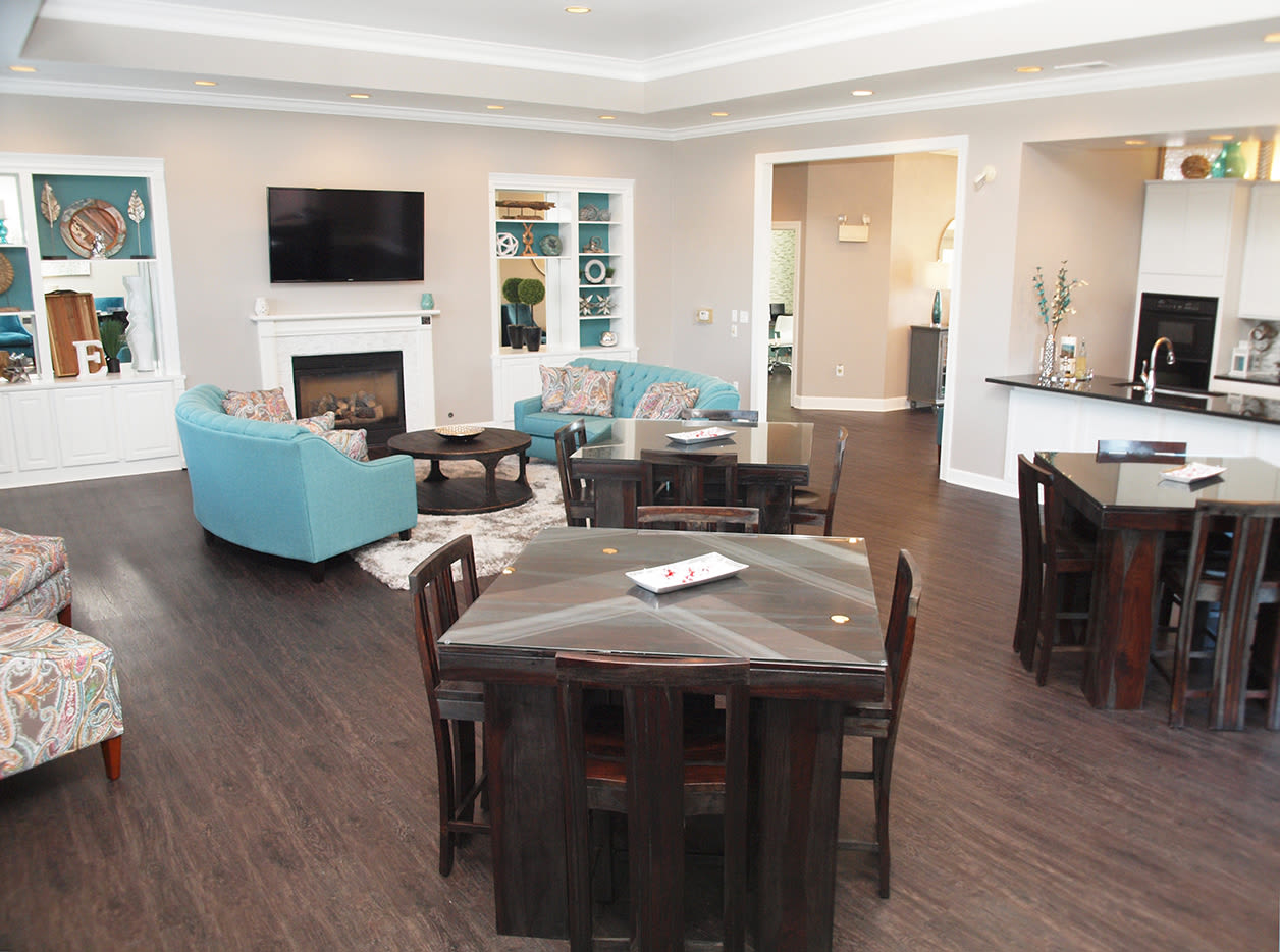 Spacious clubhouse community space with fireplace at Emerald Lakes in Greenwood, Indiana