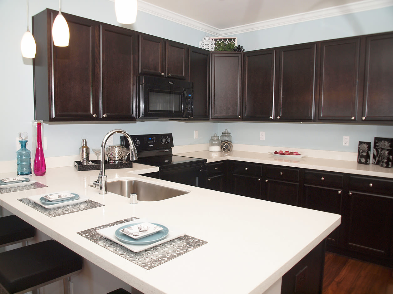 Modern kitchen featuring a breakfast bar at Kendal on Taylorsville in Louisville, Kentucky
