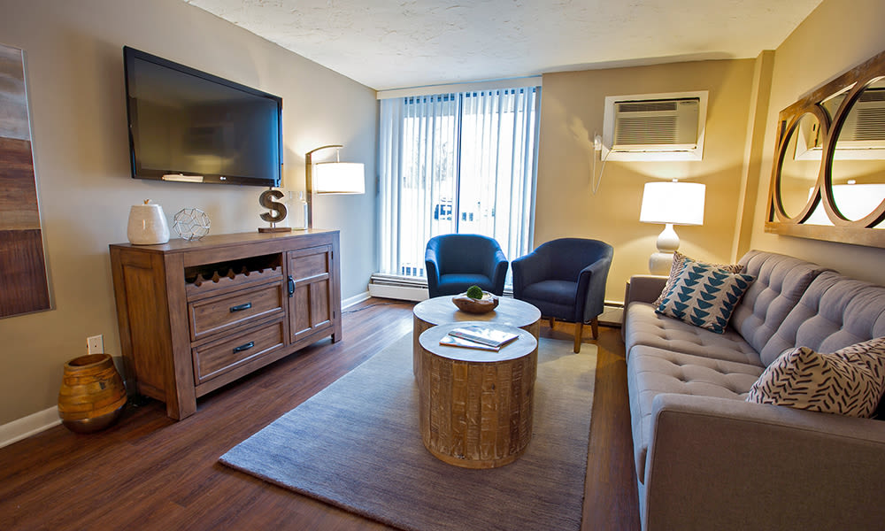 Gorgeous living room at Solon Club Apartments in Oakwood Village, OH