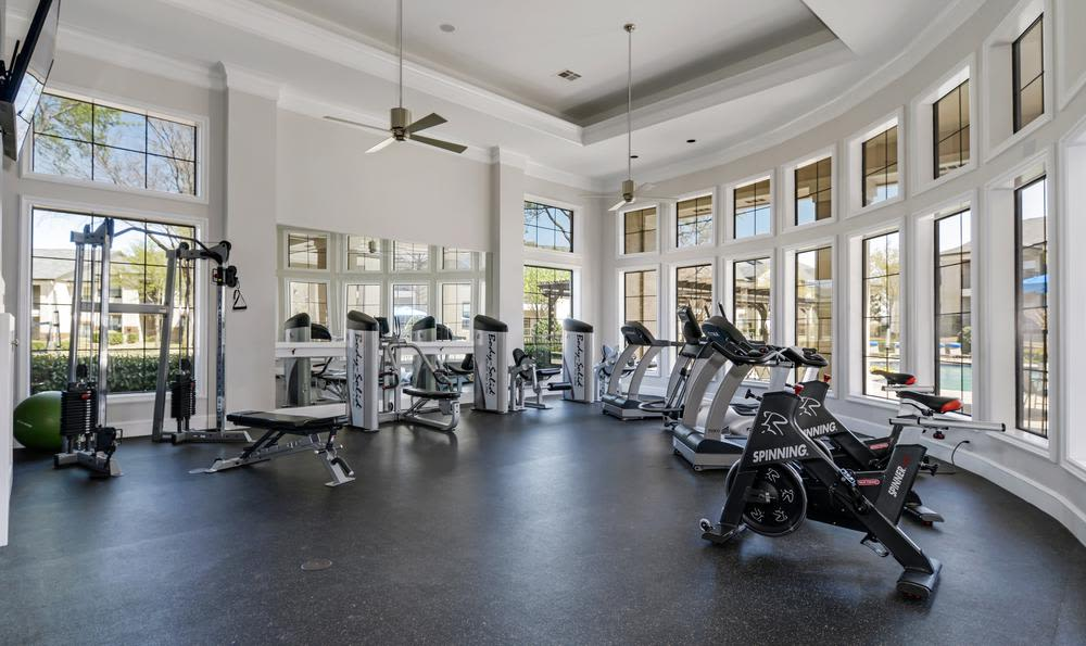 Fitness center at apartments in Mansfield, TX