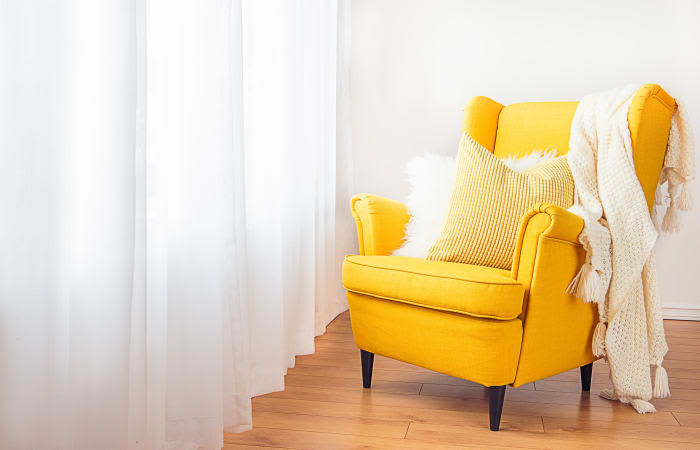 Natural light and a yellow wingback chair at Saskatoon Tower in Saskatoon, Saskatchewan