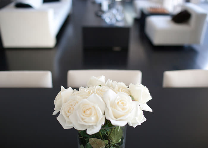 White roses and modern decor in an apartment at The Waterford Tower in Mississauga, Ontario.