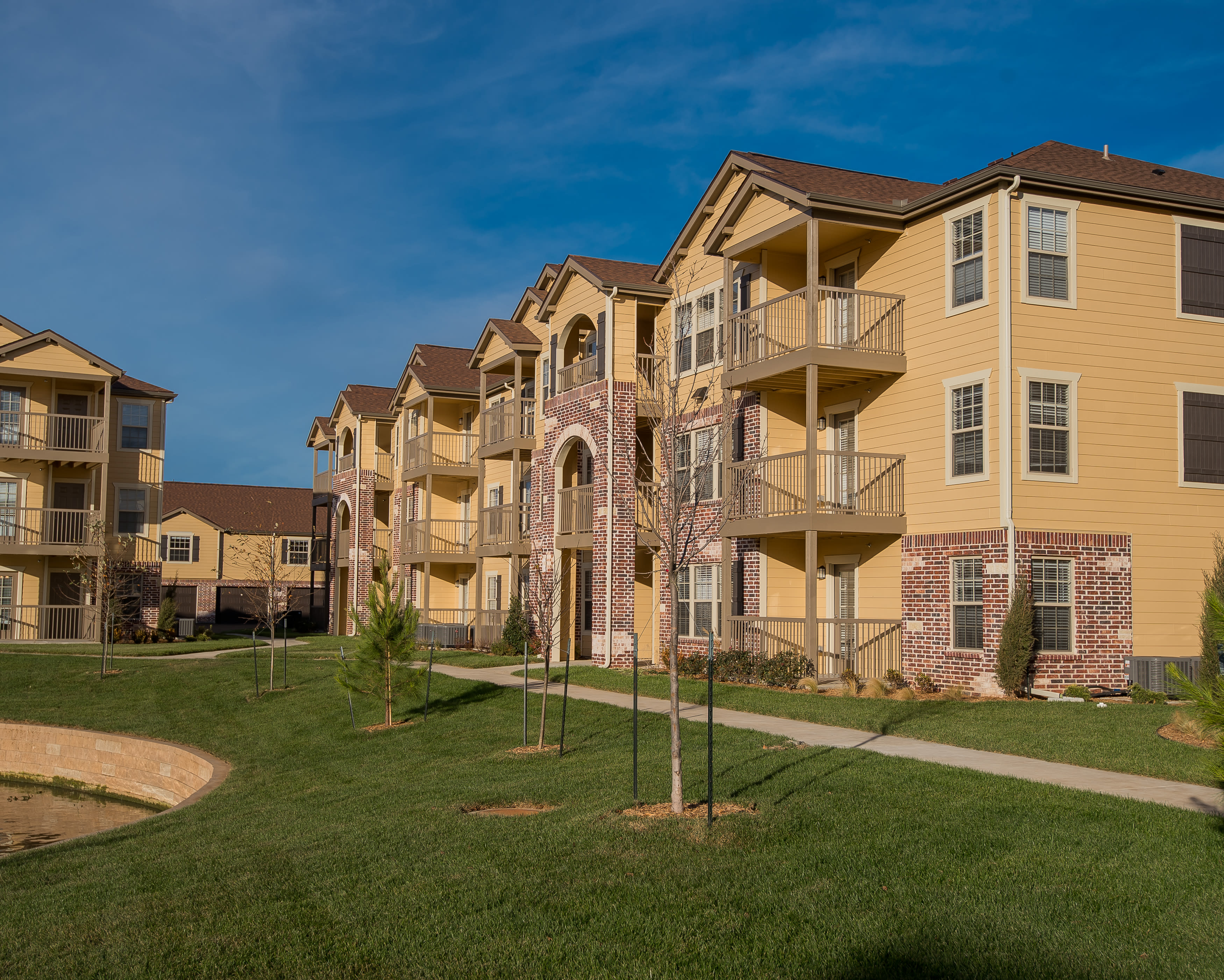 Green areas at Portico at Friars Creek Apartments in Temple, Texas