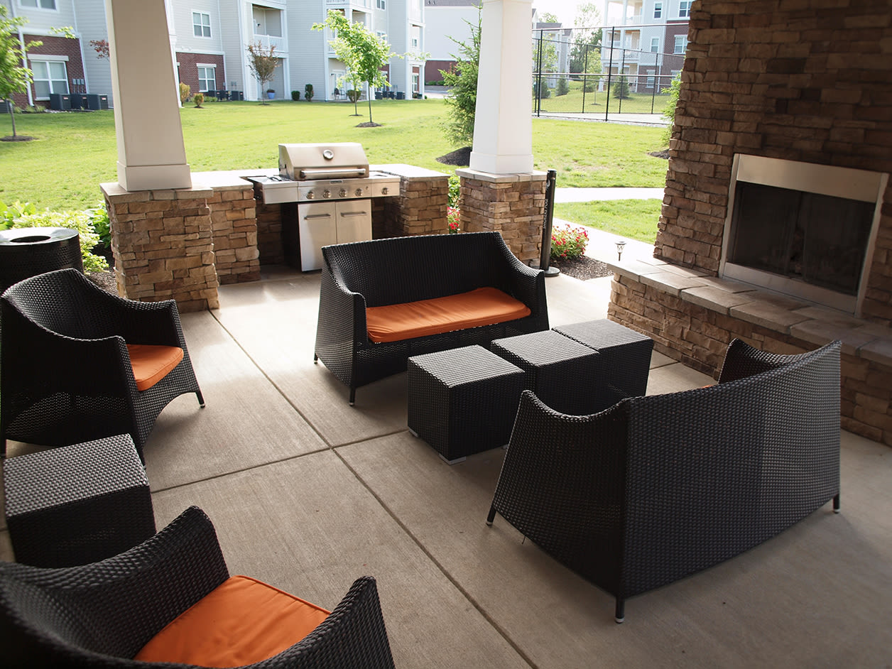 Outdoor community space featuring a bbq and fireplace at Meridian on Shelbyville in Louisville, Kentucky