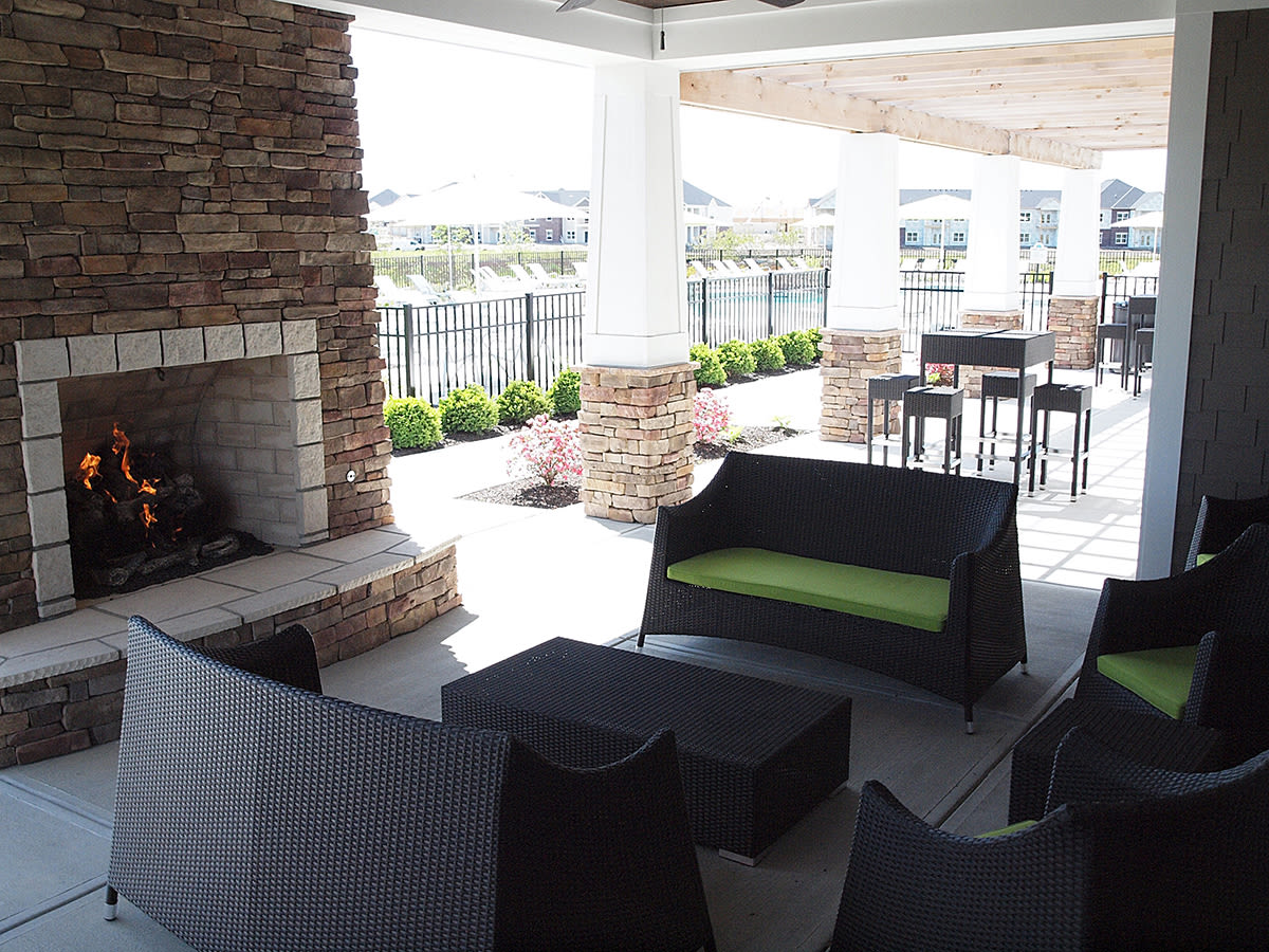 Outdoor patio and fireplace at Palmera Apartments in Mason, Ohio