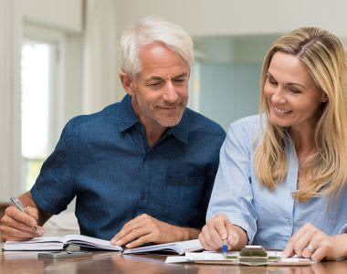 Senior and his daughter checking financial options of All American Assisted Living at Kingston