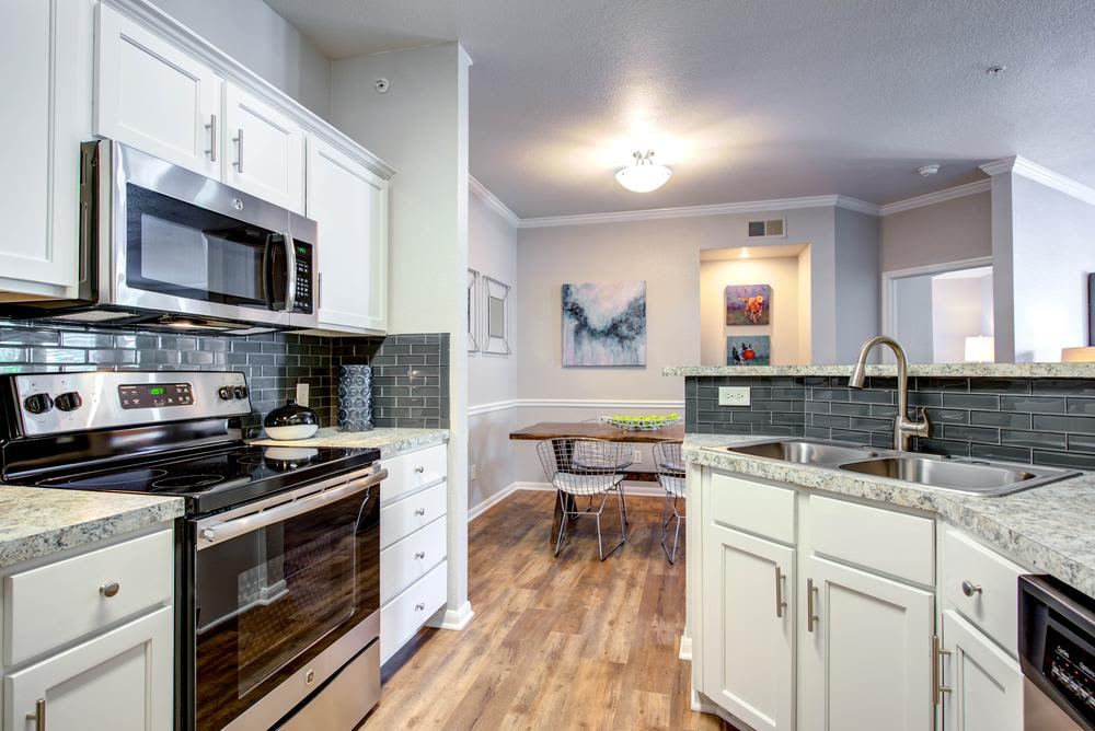Modern kitchen at The Gates at Buffalo Ridge Apartments in Haltom City, Texas