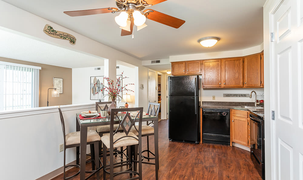 Dining room and kitchen view at Maplewood Estates Apartments in Hamburg, New York