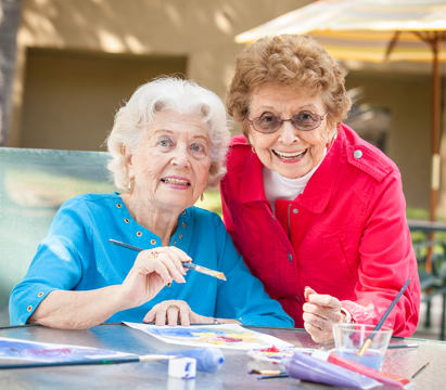 Independent Living residents painting at Emerald Court