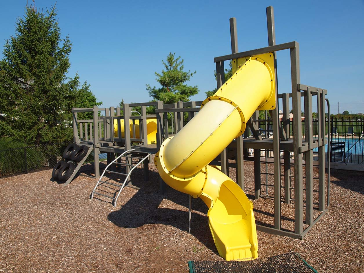 Kids play structure at Wellington Place Apartments