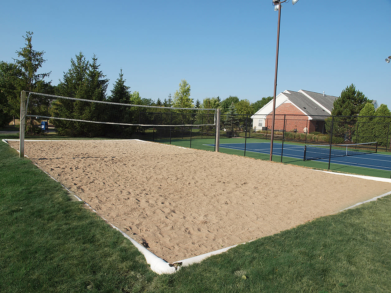Beach volleyball court at Wellington Place Apartments