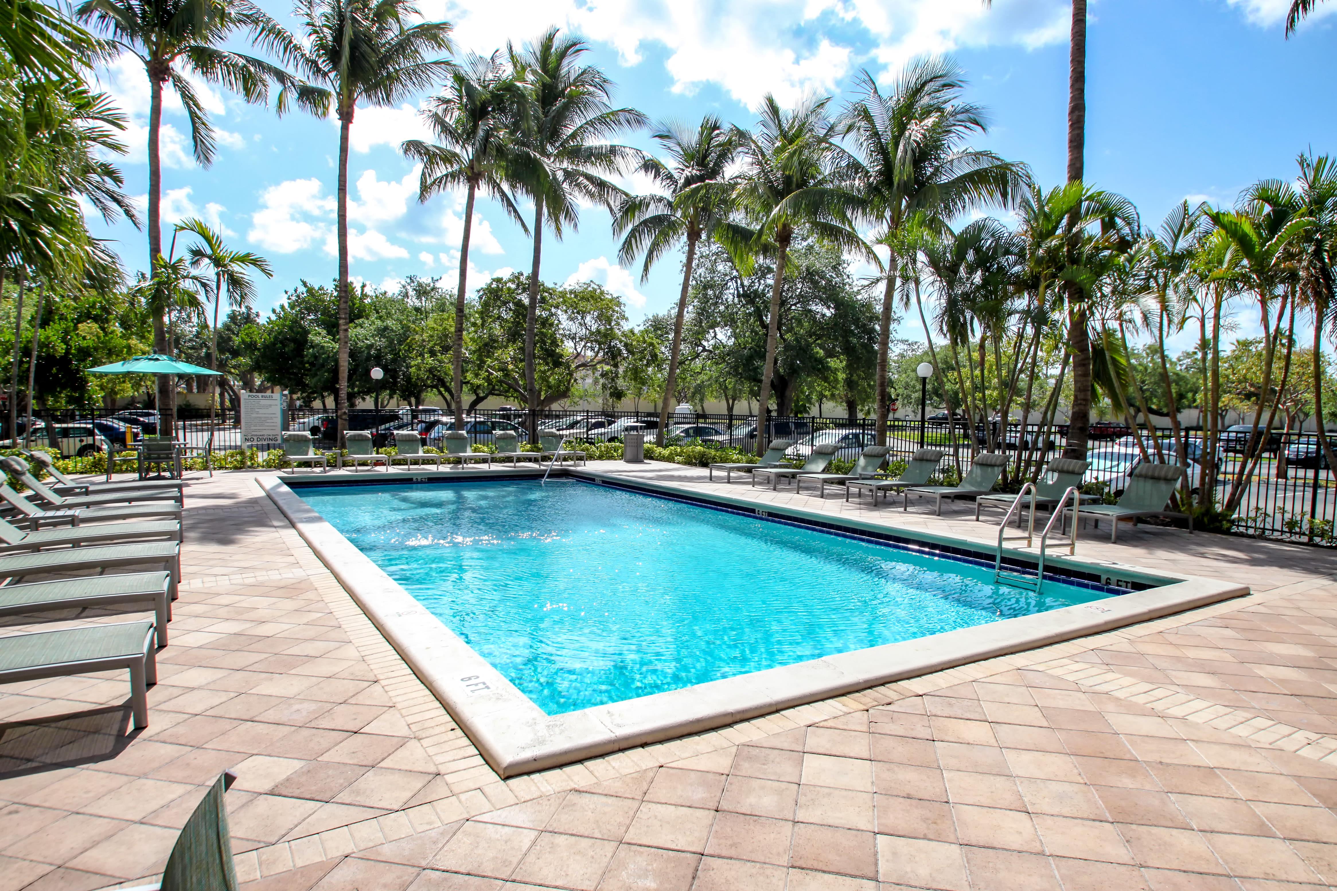 Sparkling swimming pool at Aliro Apartments in North Miami, FL