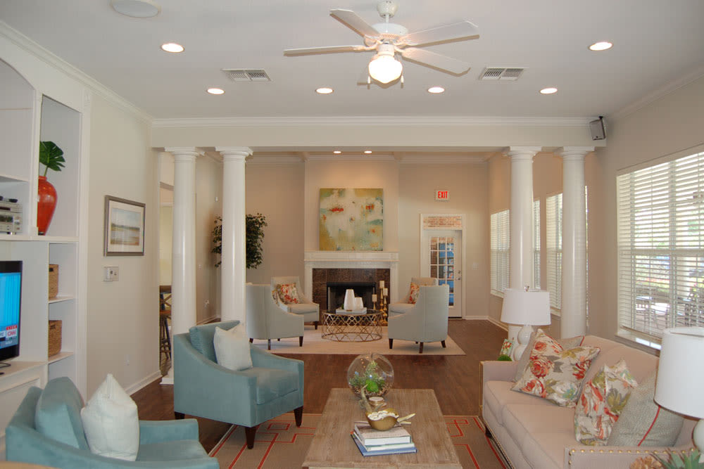 Community clubhouse lounge at The Village at Westlake Apartment Homes in Shreveport