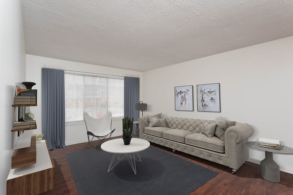 Living room at Waverlywood Apartments & Townhomes in Webster, New York