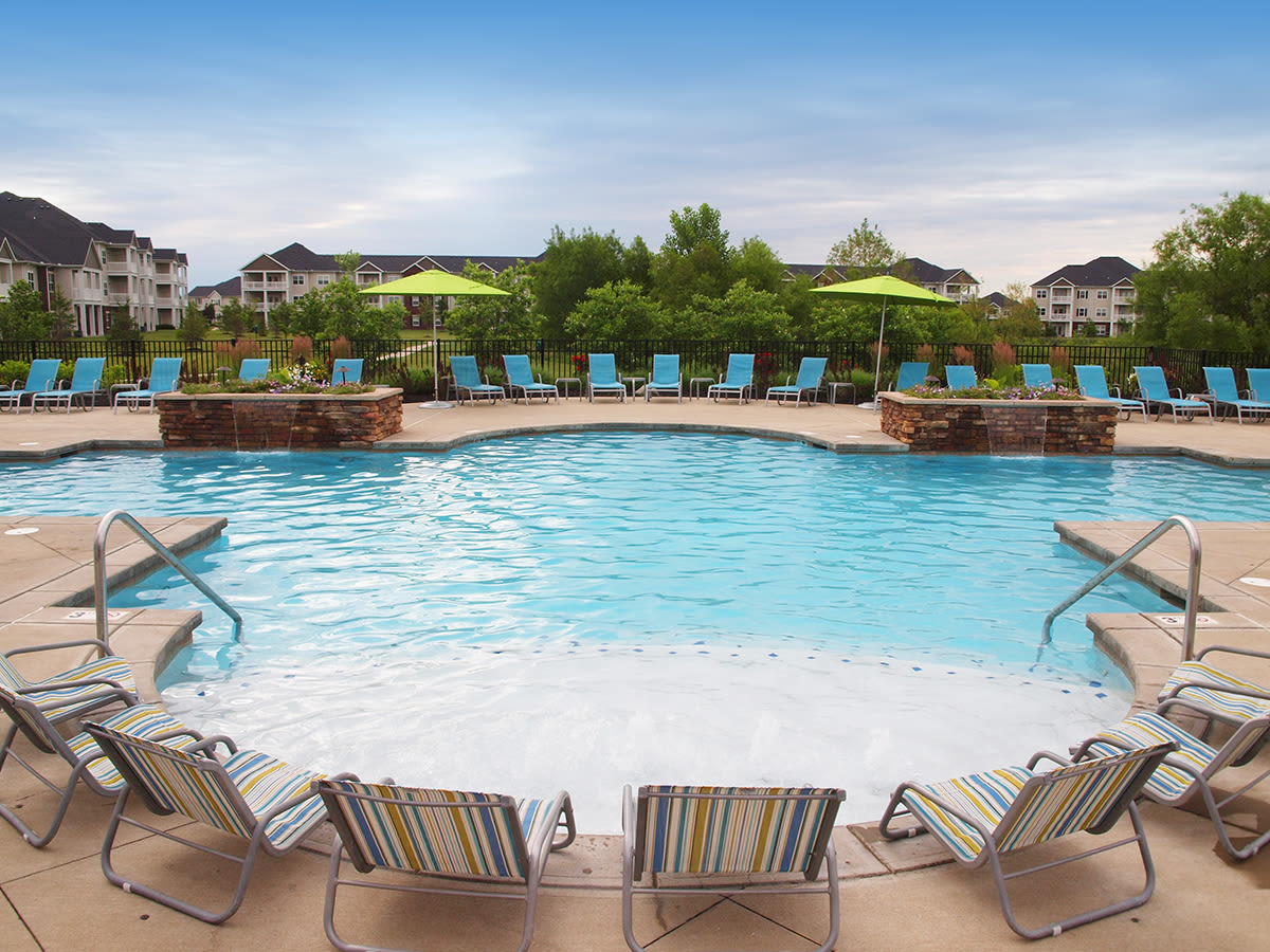Outdoor pool and chairs at Palmera Apartments in Mason, Ohio