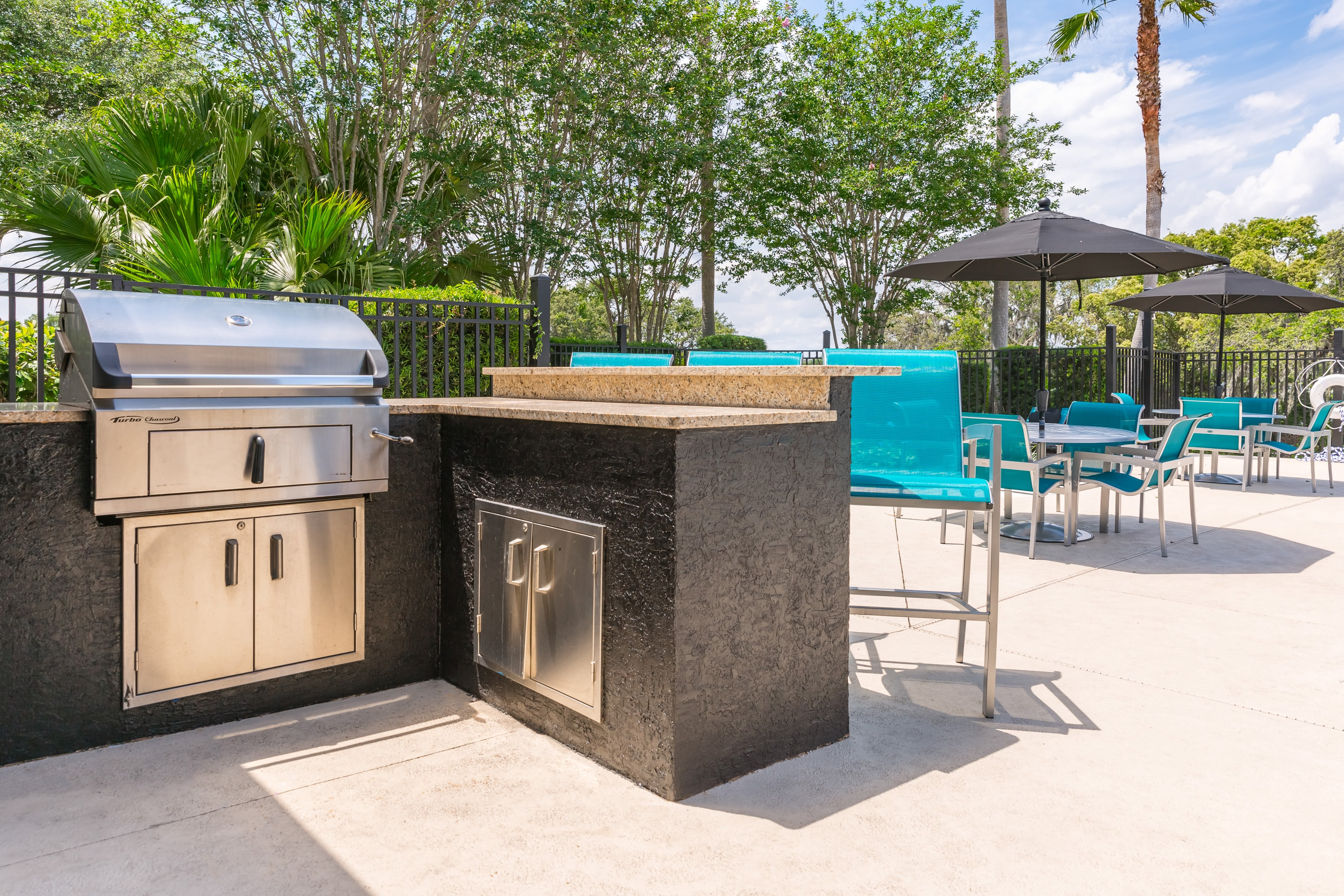 outdoor grilling areas at The Avenue in Ocoee