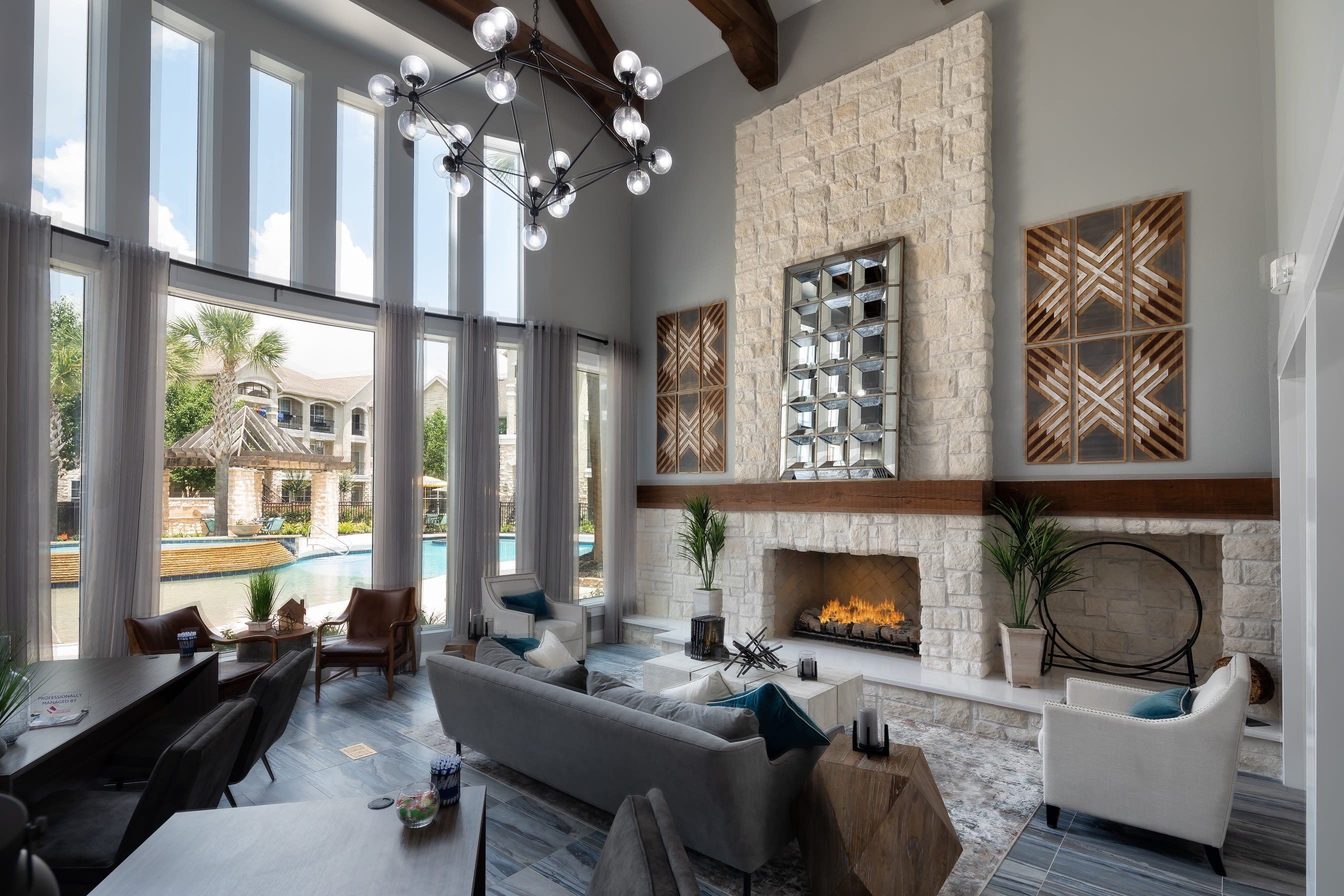 Clubhouse with amenities poolside at The Retreat at Cinco Ranch in Katy, Texas