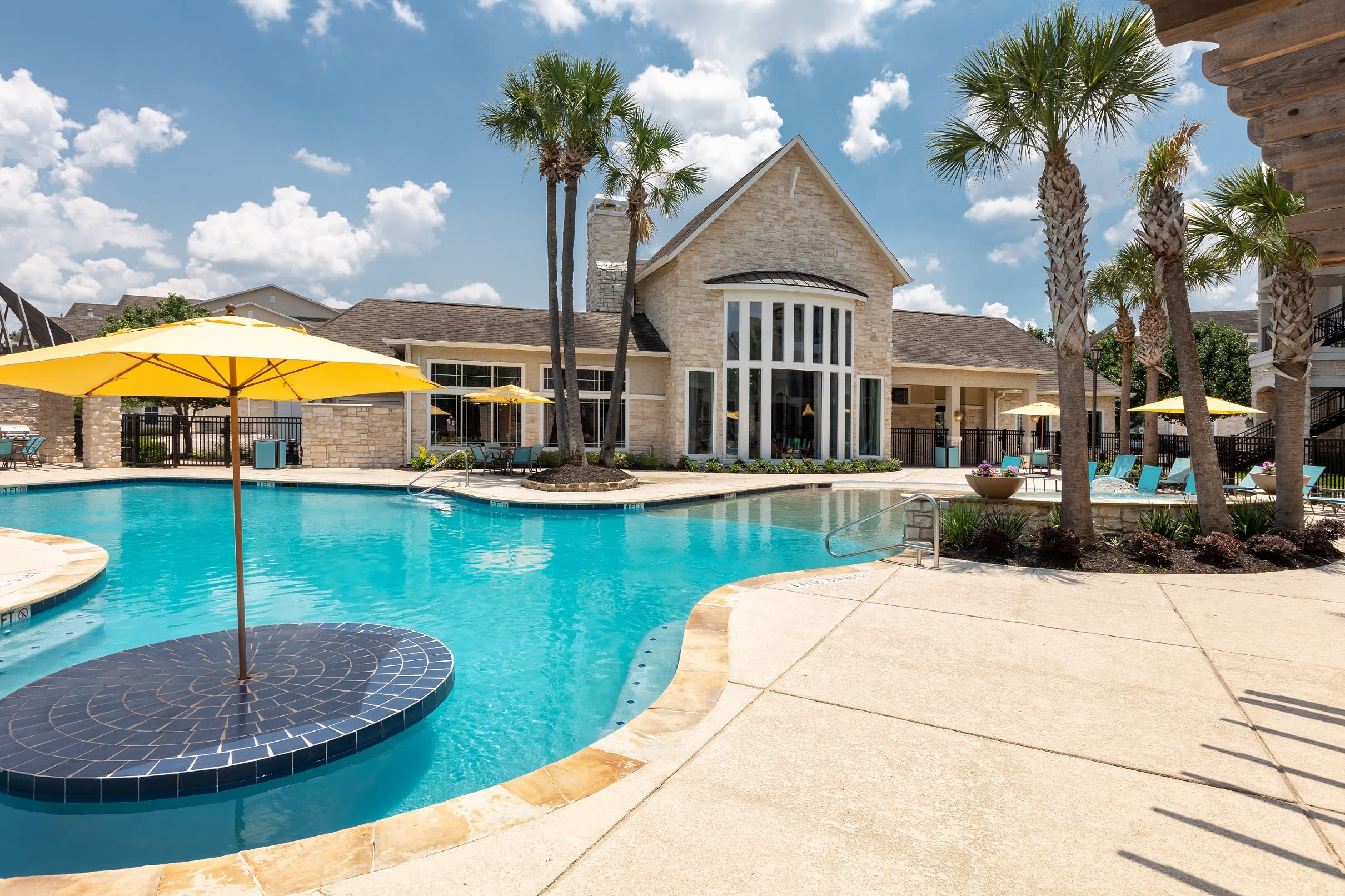 Resort style pool with lounge chairs at The Retreat at Cinco Ranch in Katy, Texas