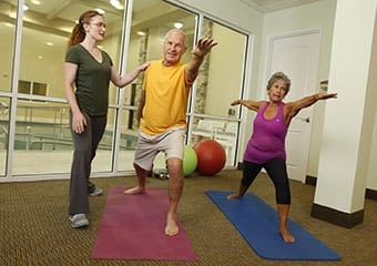 Residents doing pilates at Discovery Commons At Wildewood in California, Maryland