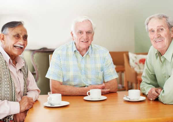 Residents gathered for coffee at Teal Lake Senior Living in Mexico, Missouri