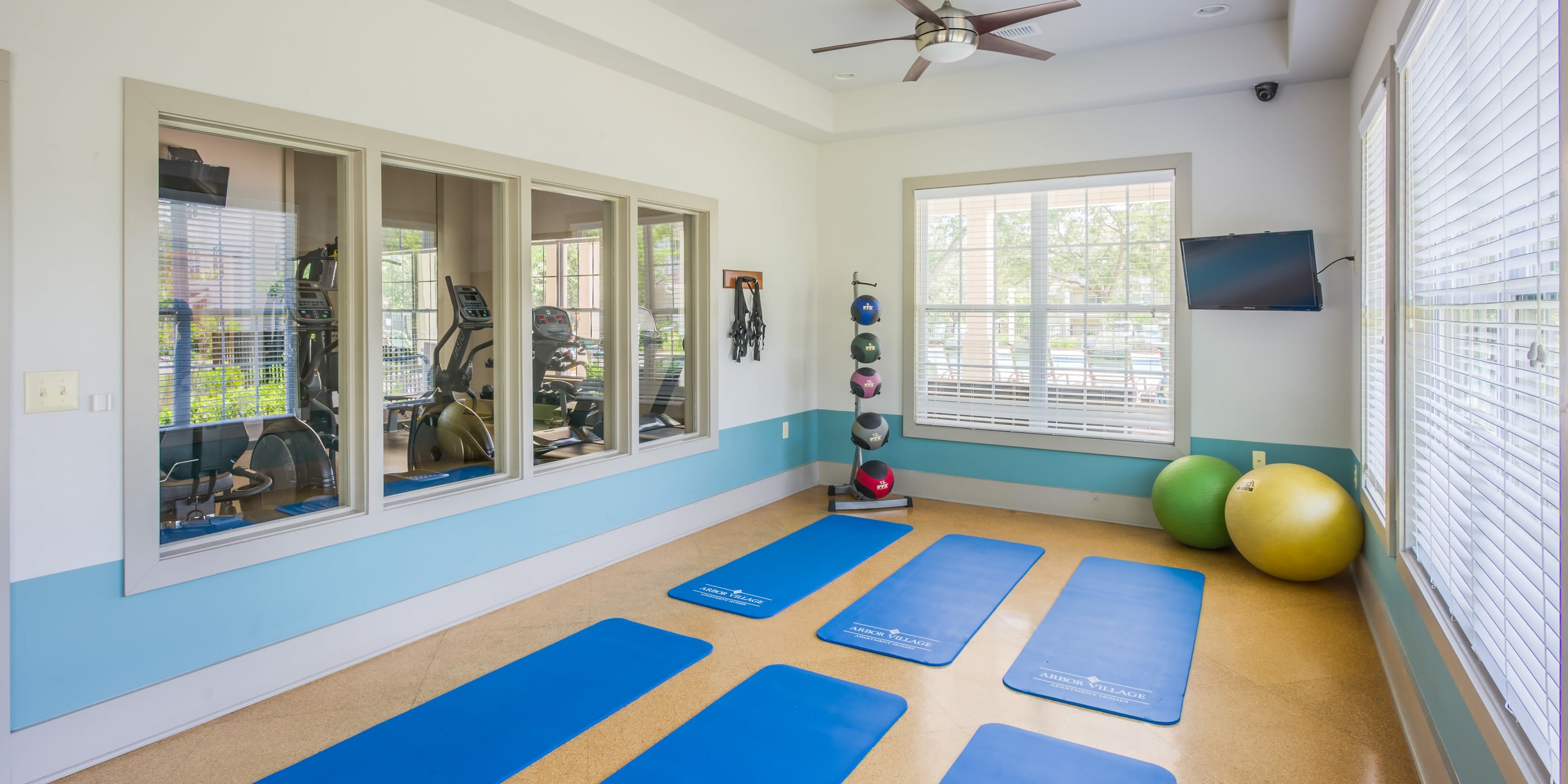 Fitness center with yoga mats at Arbor Village in Summerville, South Carolina