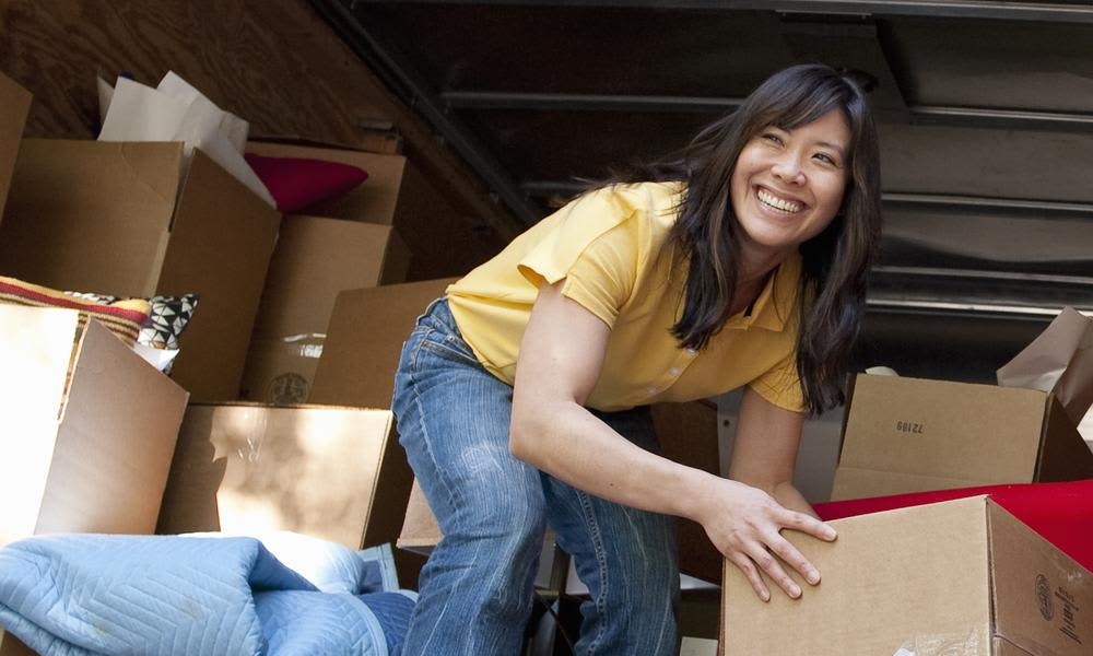 Woman helping unload boxes at A Better Self Storage Bott in Colorado Springs Colorado