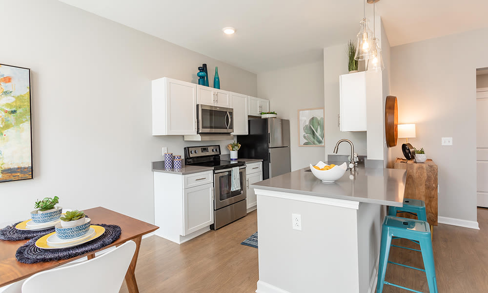 Modern and well-equipped kitchen at Woodland Acres Townhomes